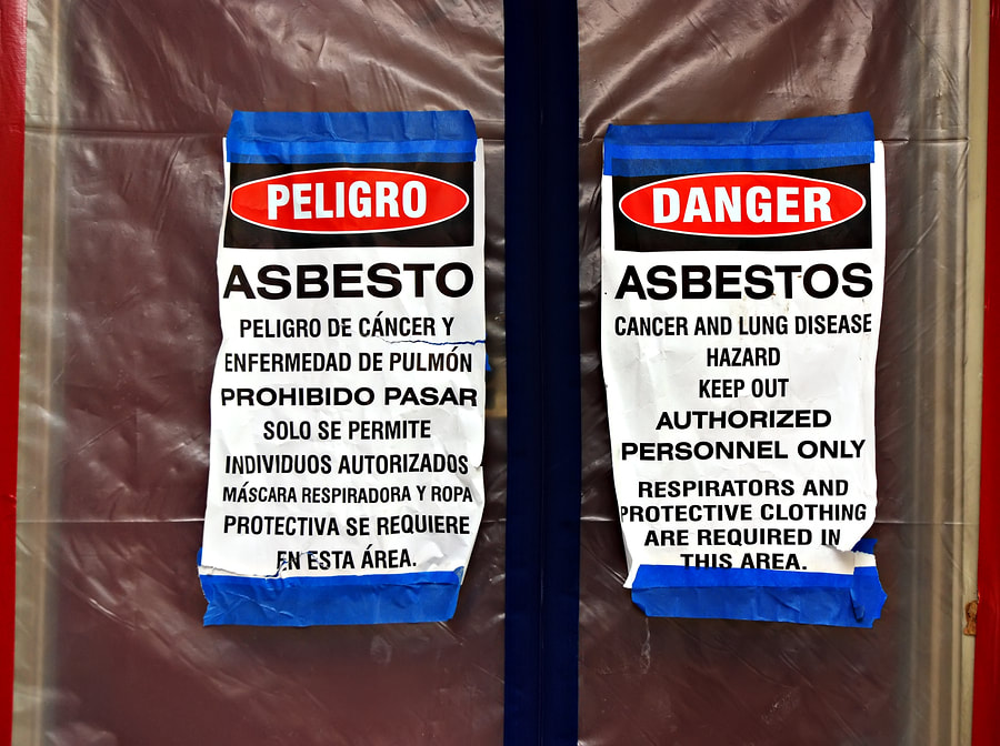 two dangers sign asbestos removal in progress